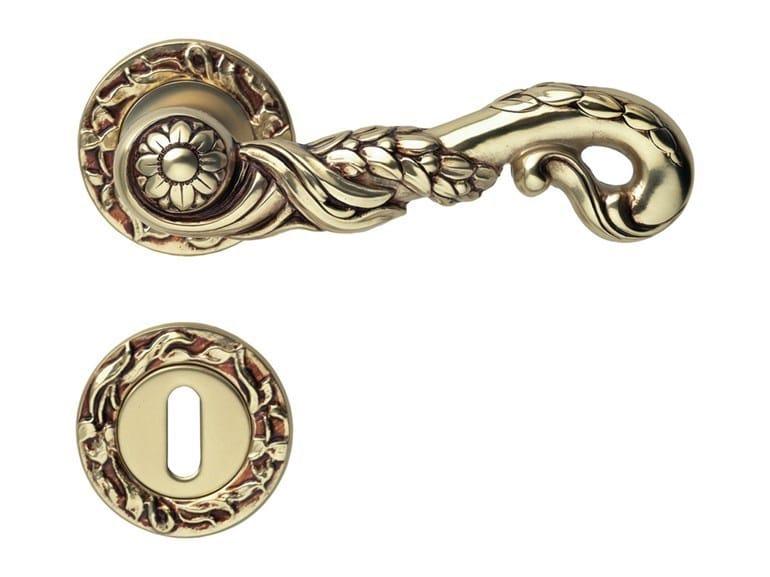 Art Nouveau brass door handle on rose with lock POESIA | Door handle on rose by LINEA CALI'