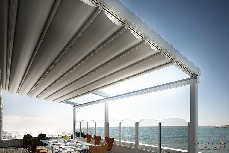 Wall-mounted aluminium pergola with sliding cover STAR by DIRELLO
