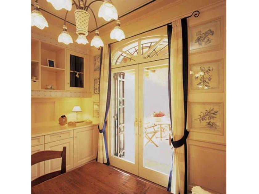 Mahogany patio door EURO 68 | Pocket slinding window by CARMINATI SERRAMENTI
