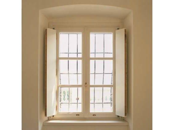 Wooden casement window EURO 68 | Casement window by CARMINATI SERRAMENTI