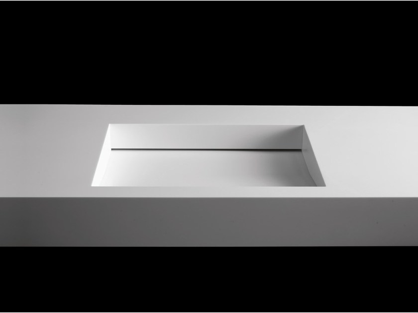 Custom washbasin with integrated countertop TICKLESS by RIFRA