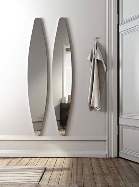 Oval wall-mounted mirror DIOSCURI by RIFLESSI