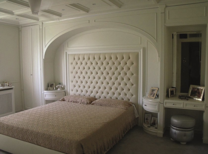 Double bed with upholstered headboard Double bed by Turati & C.