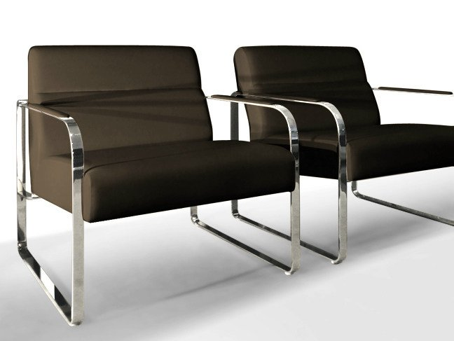 Sled base easy chair with armrests LLOYD WAITING | Easy chair by JOSE MARTINEZ MEDINA