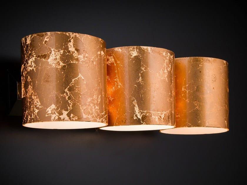 Brick applique by metal lux