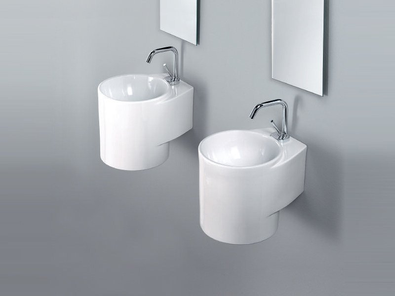 Wall-mounted handrinse basin round TUBE by A. e T. Italia