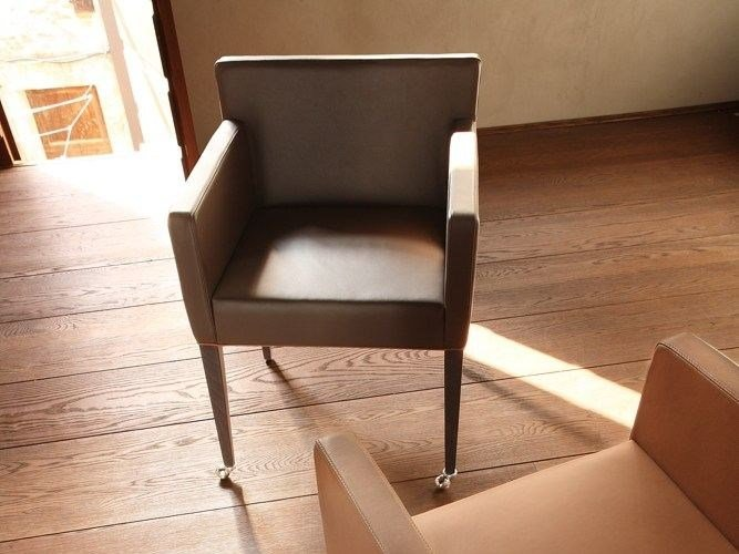 Leather easy chair with armrests with casters CORTINA   Easy chair by COLLI CASA