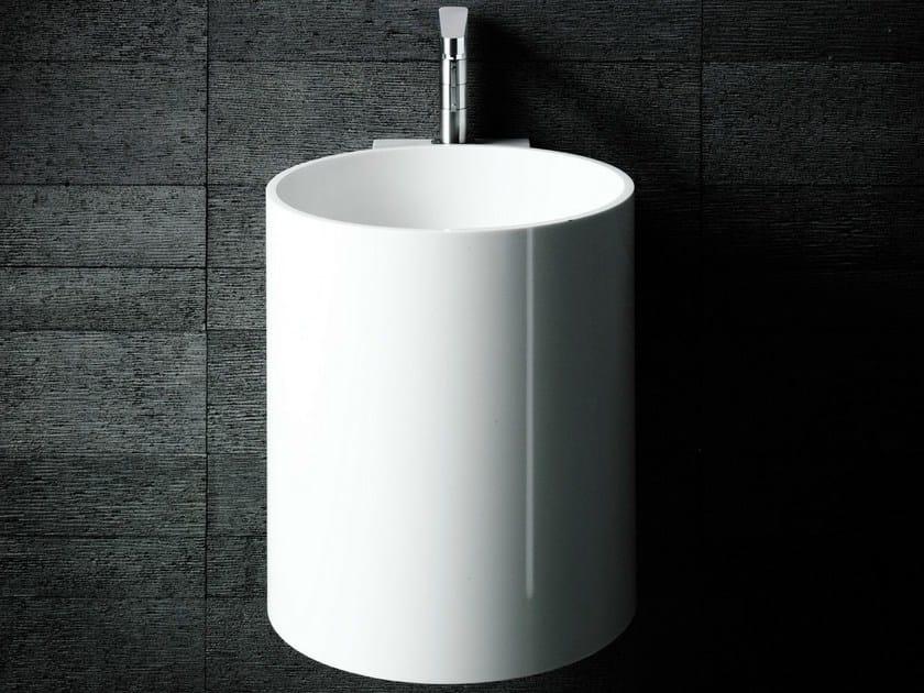 Wall-mounted Corian® handrinse basin round PHW by Boffi