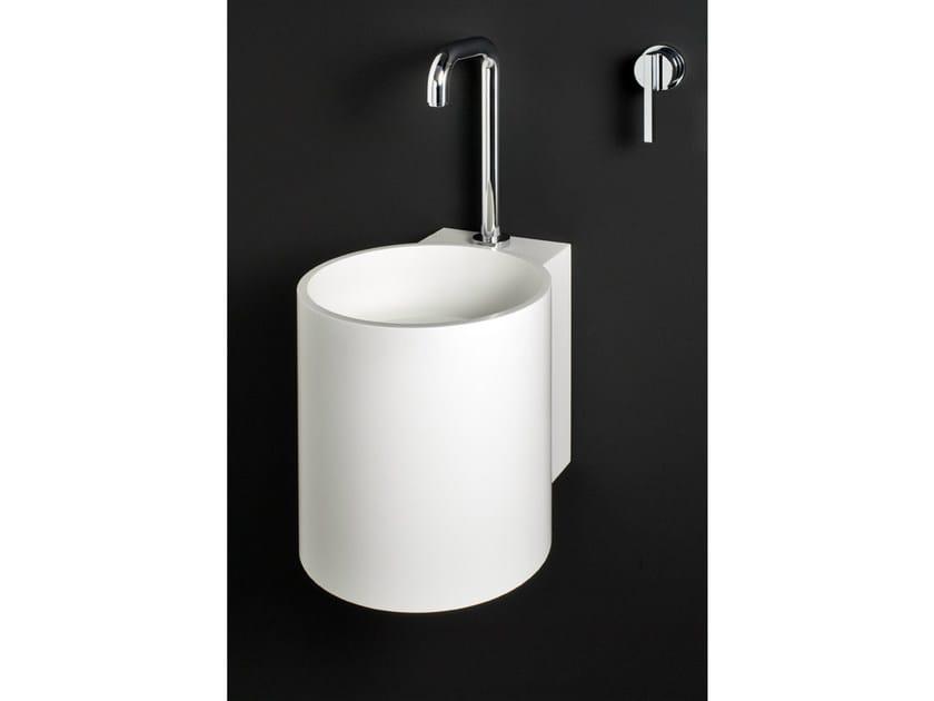 Wall-mounted Corian® handrinse basin round PHWS by Boffi