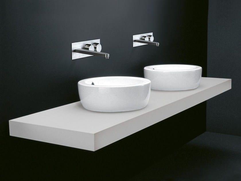 Round single Corian® washbasin I FIUMI   Round washbasin by Boffi