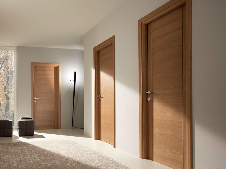 Hinged solid wood door PANGEA | Oak door by GAROFOLI