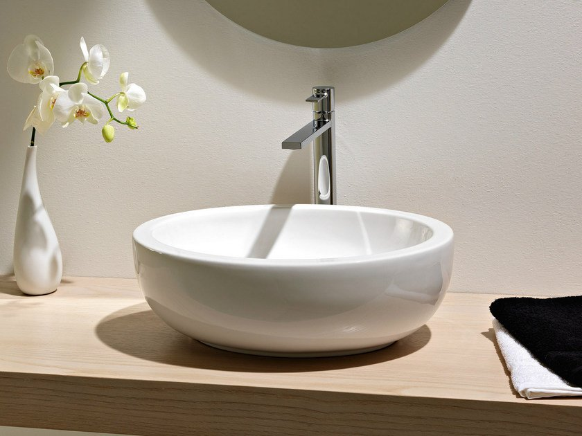 Countertop oval ceramic washbasin PLANET | Washbasin by Scarabeo Ceramiche