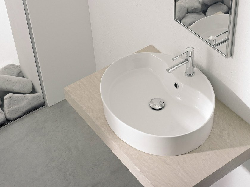 Countertop round ceramic washbasin WIND R by Scarabeo Ceramiche