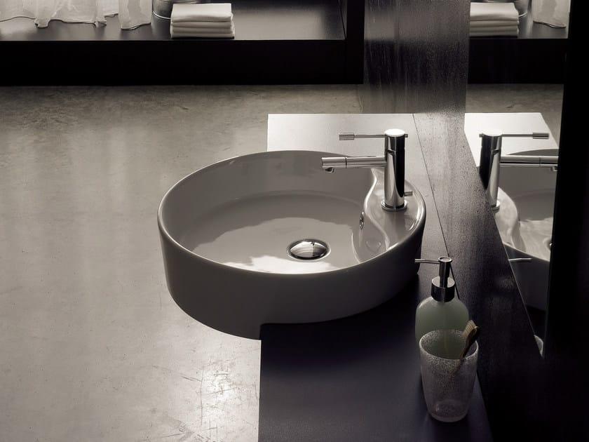 Semi-inset round ceramic washbasin GEO D by Scarabeo Ceramiche