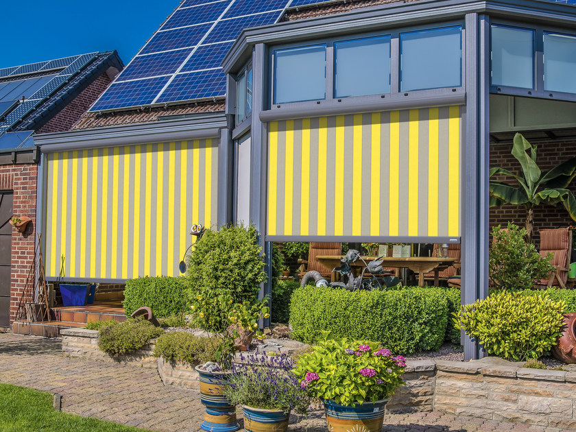 Box awning with guide system MARKILUX 869 / 869 tracfix by markilux