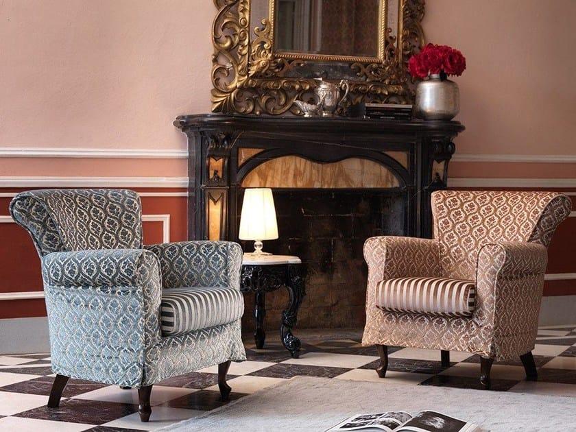 Upholstered fabric armchair 070 | Armchair by Domingo Salotti