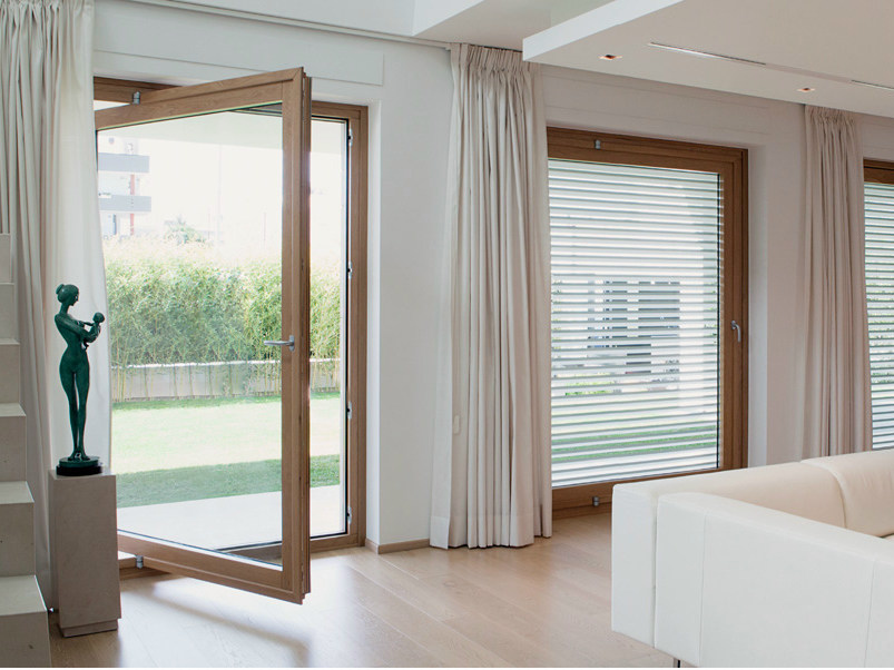 Laminated wood patio door EXTER ALU DESIGN | Horizontally pivoted window by De Carlo