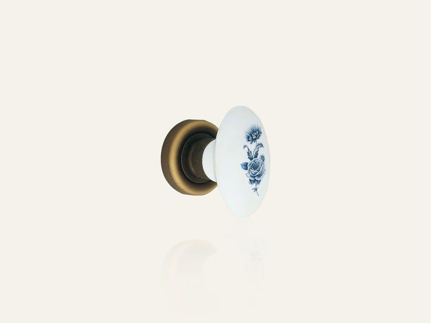 Bronzo opaco + porcellana bianca fiore blu