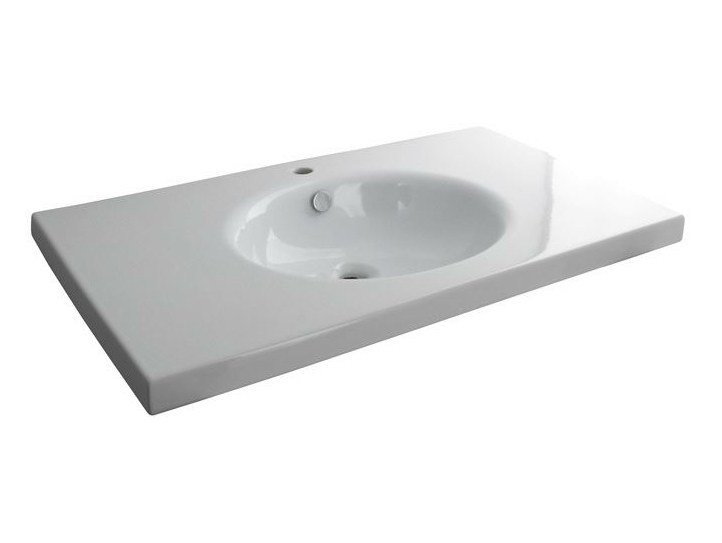 Inset oval washbasin with integrated countertop HOTELS | Washbasin for hotel rooms by Noken