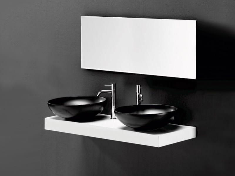 Countertop ceramic washbasin THIN TONDO by A. e T. Italia