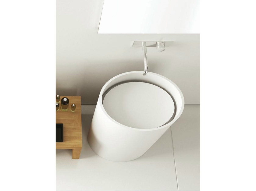 Freestanding Corian® washbasin TOWER ELIPSE by MOMA Design
