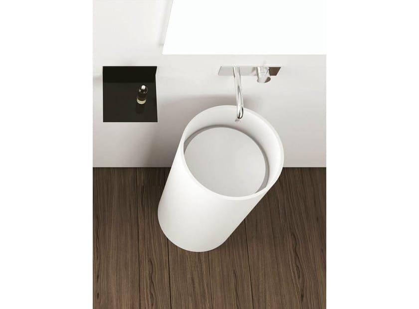 Freestanding round Corian® washbasin TOWER ROUND by MOMA Design