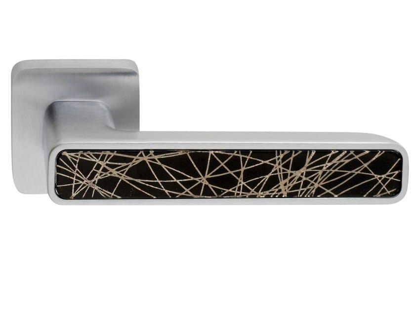 Zamak door handle on rose INNER GLASS   Door handle by Frascio