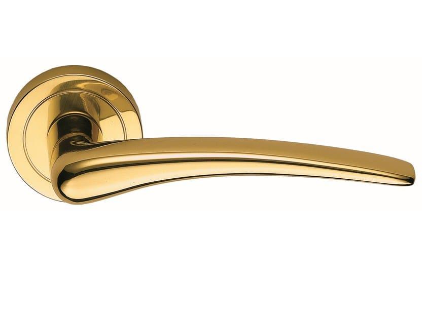 Polished brass door handle on rose HALLEY | Door handle by Frascio