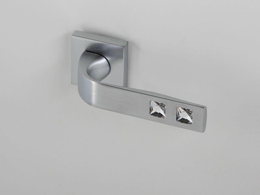 Door handle on rose satin chrome NUIT   Door handle by Frascio