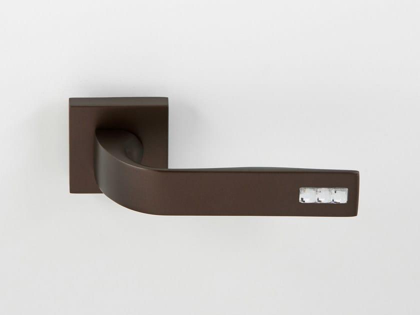 Door handle on rose bronze JOUR   Door handle by Frascio