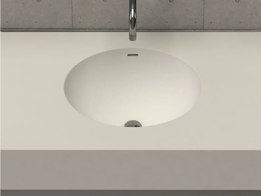 Oval wall-mounted washbasin with integrated countertop ELI DESK by DIMASI BATHROOM