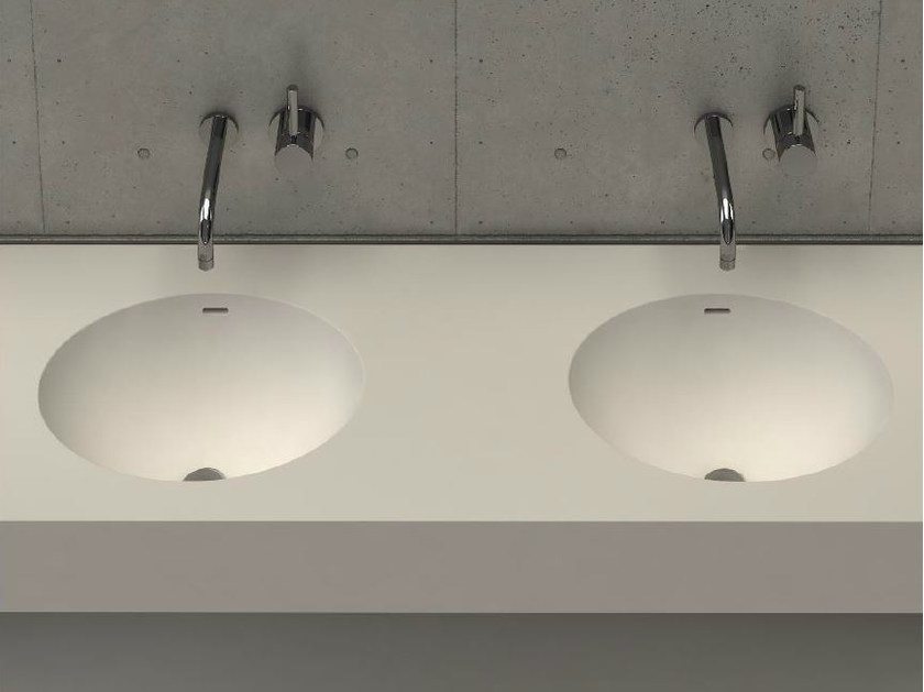 Oval wall-mounted washbasin with integrated countertop ELI DESK D by DIMASI BATHROOM