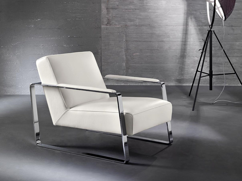 Sled base upholstered easy chair with armrests MIKA by Divanidea