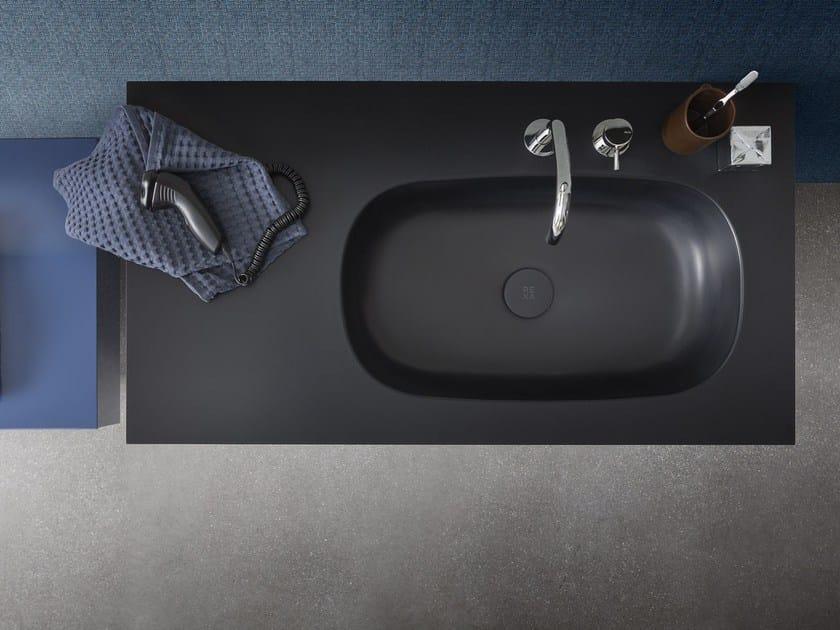 Corian® washbasin countertop MOODE | Washbasin countertop by Rexa Design