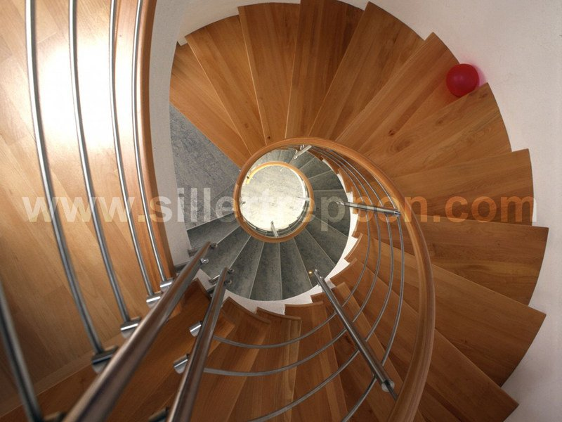 Stainless steel and wood Spiral staircase CLASSIC | Spiral staircase by Siller Treppen