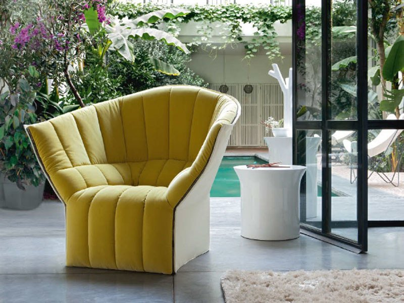 Upholstered fabric armchair with armrests MOËL by Ligne Roset