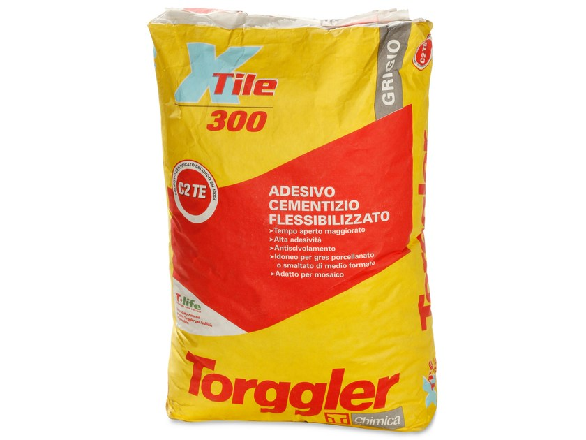 Cement adhesive for flooring X-TILE 300 by Torggler Chimica