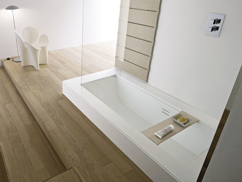Built-in Corian® bathtub with shower UNICO | Bathtub with shower by Rexa Design