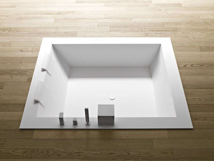 Freestanding built-in Corian® bathtub UNICO | Built-in bathtub by Rexa Design