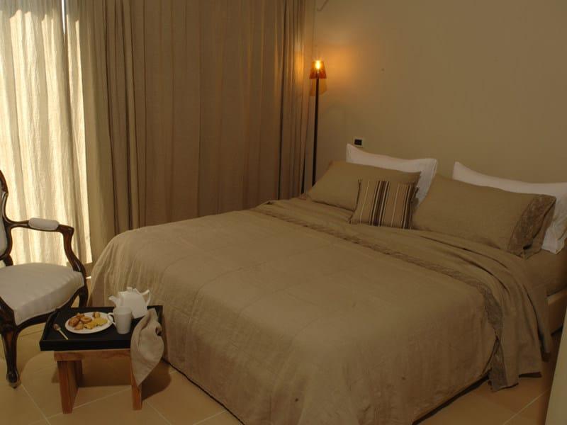 Solid-color embroidered linen bedding set CORALLI | Bedding set by LA FABBRICA DEL LINO