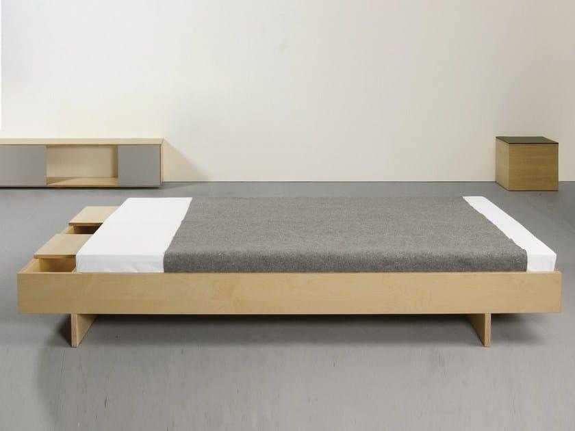 Bed with storage headboard BEZWEI by Sanktjohanser