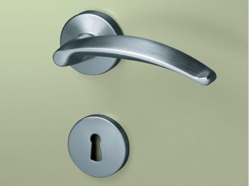 Brass door handle on rose MANOS | Door handle by KLEIS