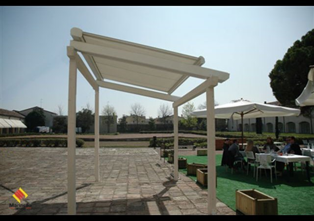 Sliding awning with guide system LUGANO by Marinello Tende