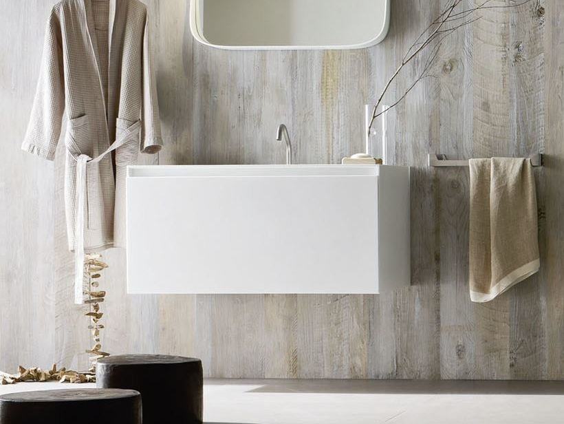 Single wall-mounted Corian® vanity unit ERGO-NOMIC | Single vanity unit by Rexa Design