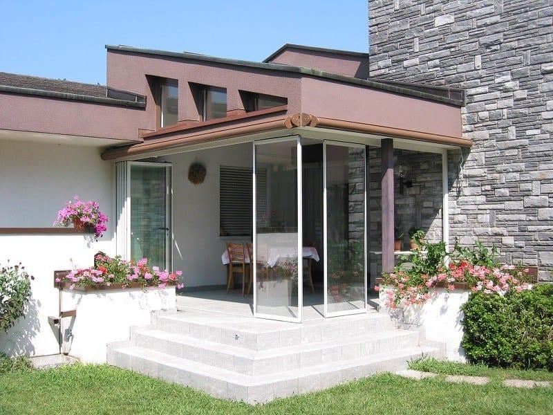 Sliding frameless glass facade PLiso By FRUBAU