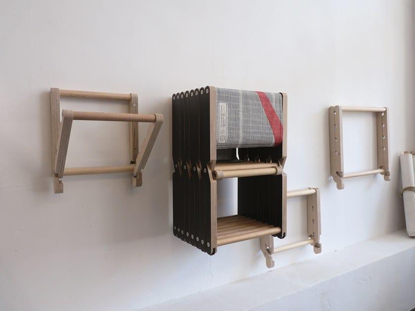 Mobile Porta Sedie Pieghevoli.Porta Sedie Pieghevoli Rack By Dvelas Design Enrique Kahle