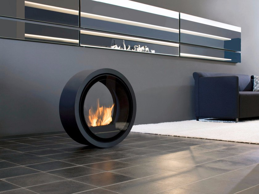 Freestanding bioethanol fireplace with panoramic glass ROLL FIRE by conmoto