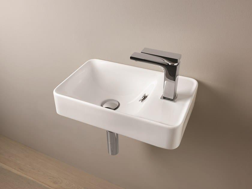 Rectangular wall-mounted ceramic handrinse basin SAVON by Artceram