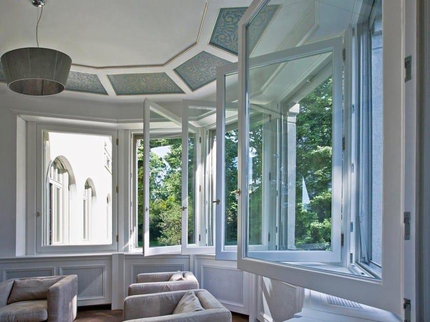 Finestra a battente a taglio termico in legno SC80-100   Finestra a battente by Capoferri Serramenti