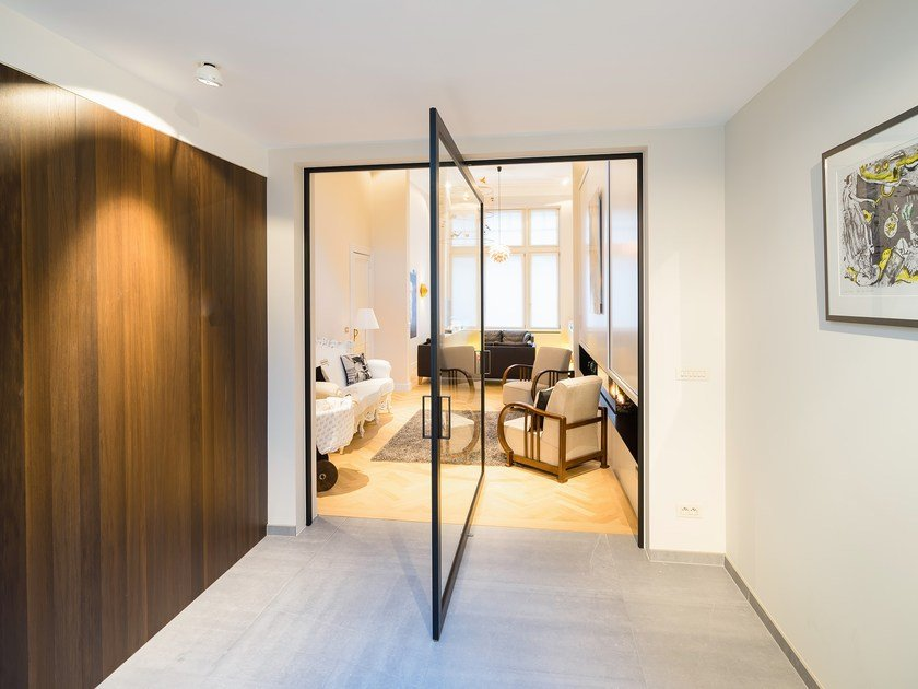 Glass and aluminium central axis pivot door SKD75 BLACK by Anyway Doors